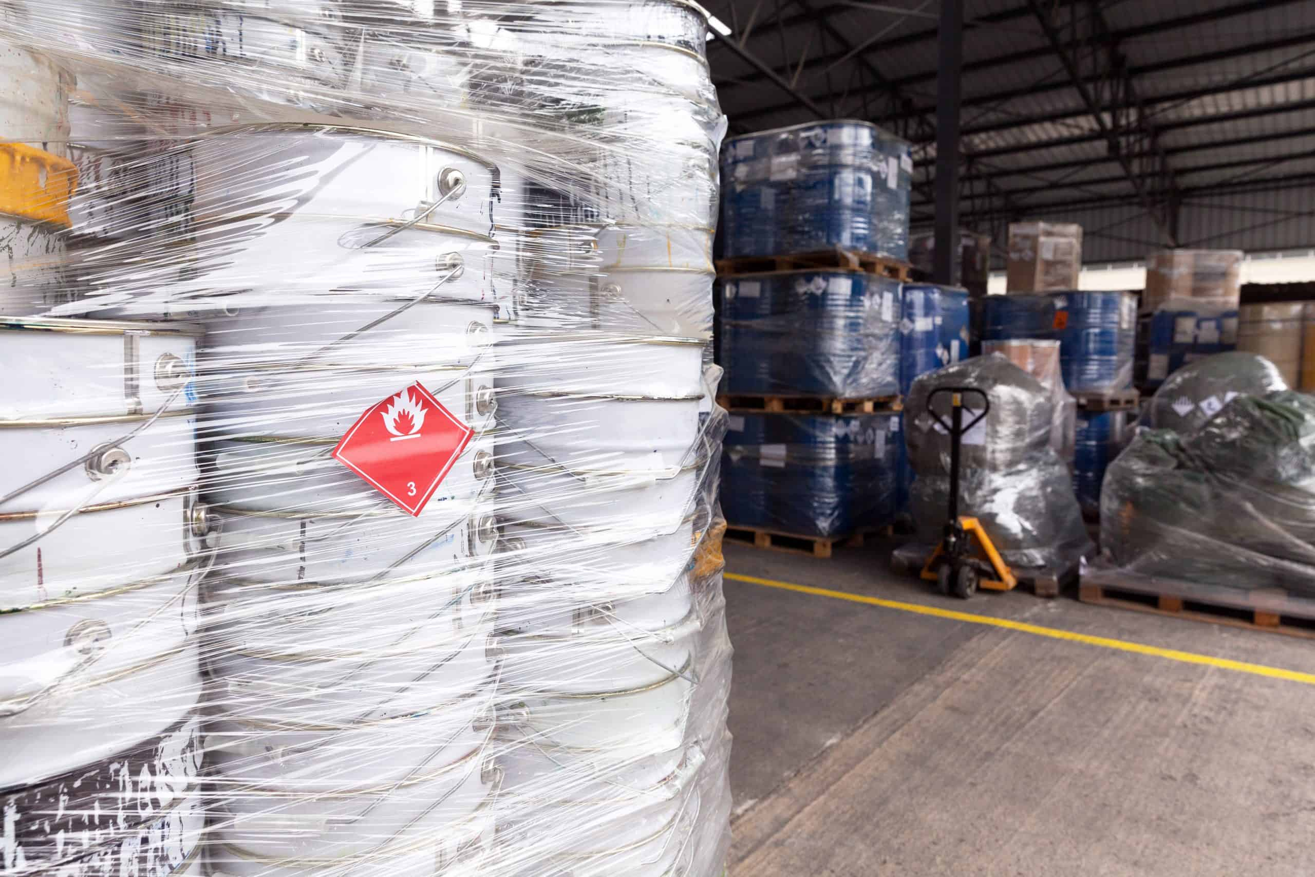 Waste barrels with hazard warning symbol in the warehouse